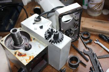 """<br><a href=""""http://www.glue-it.com/tools/milling-machines/mini-mill-gearbox/"""">broken gears in the Mini Mill</a> resulted in a swap to metal gears and then a <a href=""""http://www.glue-it.com/tools/milling-machines/mini-mill-belt-drive/"""">homemade belt drive system</a>"""