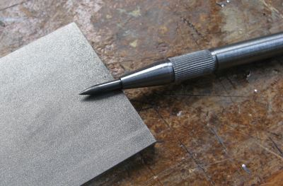 sharpening a scriber on a diamond pad