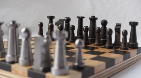"""<br><a href=""""https://www.glue-it.com/wp/gallery/chess-men/"""">Chess set</a> made from mild steel and <a href=""""https://www.glue-it.com/wp/gallery/chess-board/"""">chess board</a> made from bog oak and ash."""