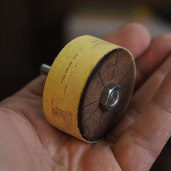 sandpaper wrapped and glued to wooden drum