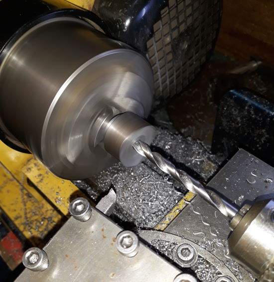 drilling a hole in the part in the lathe