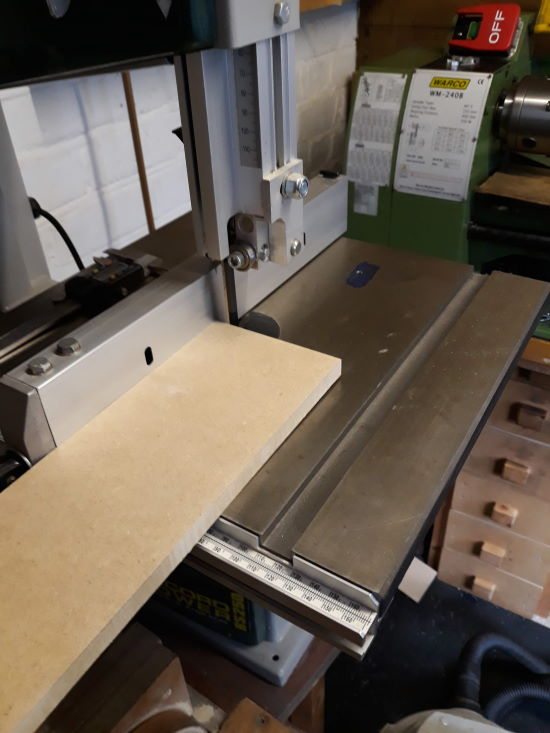 an mdf cutting board added to the bandsaw