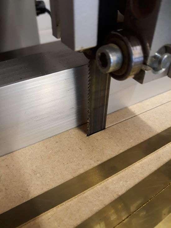 closeup of bandsaw cutting blade