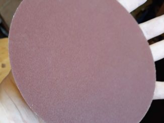 old adhesive sandpaper disc