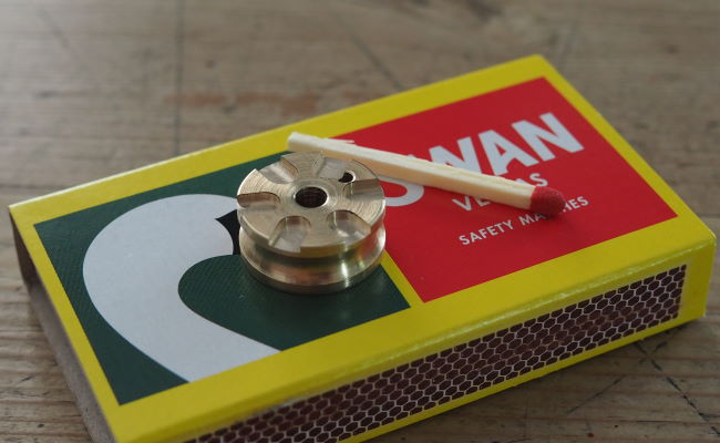 front wheel hub laying on box of matches