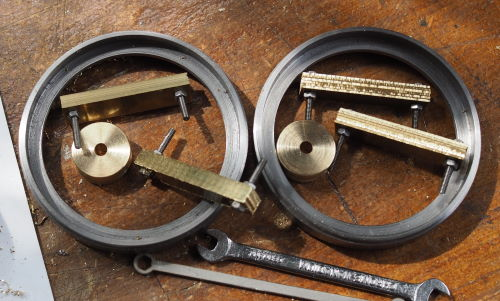 four sets of brass spokes bolted together