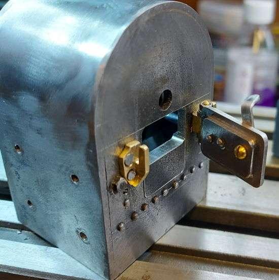 aperture machined in firebox door