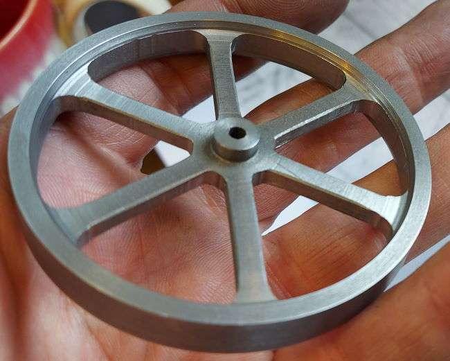 thinner rim, chamfer and longer spokes on the flywheel